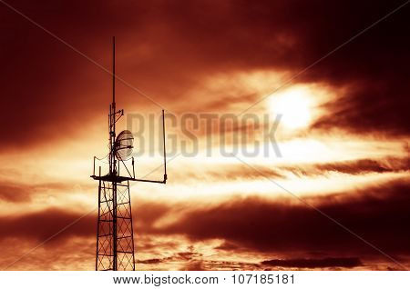 Silhouette Shot Of Television And Radio Antenna Pylon With Cloudy Sky