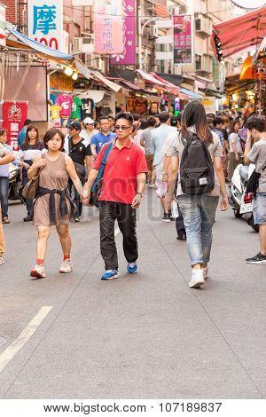Shoppers Walking Through Danshui Pedestrian Shopping Area