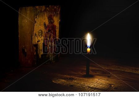 Ancient Icon Illuminated By Candle Light.