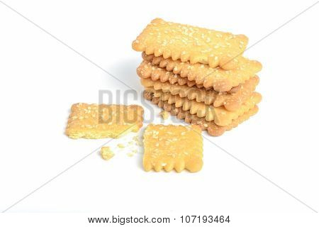 Biscuits pile and a piece that measles on white background