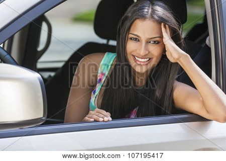 Beautiful Indian Asian young woman girl female driving a car