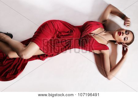 Gorgeous Sensual Woman With Elegant Hairstyle,wears Red Dress And Bijou