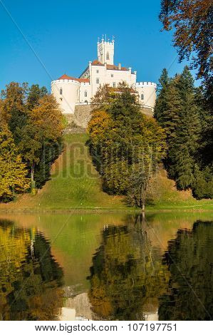 Castle of Trakoscan on the hill in autumn, Zagorje, Croatia, reflection on the lake