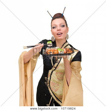 Woman Wearing A Traditional Dress Eating Sushi, Isolated On White