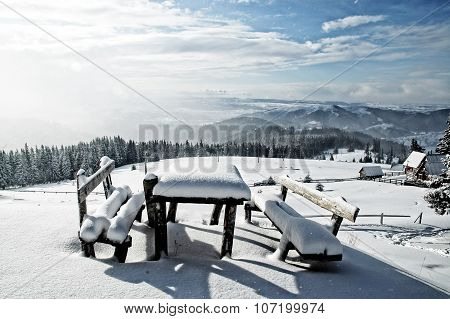 Table And Bench Covered By Fresh Snow After Blizzard