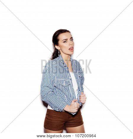 Pretty Girl In A Blue Plaid Shirt Flirting And Licks Tongue Lips