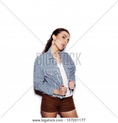 Pretty Woman In A Blue Plaid Shirt Flirting And Licks Tongue Lips