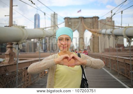 The woman took heart from hands on the walking part of the Brooklyn Bridge