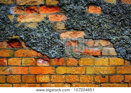 old red brickwork of abandoned building - abstract background