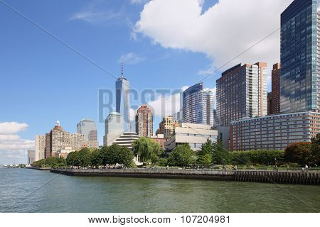 Embankment with tall buildings and Robert F. Wagner Jr. Park on coast Manhattan in New York City