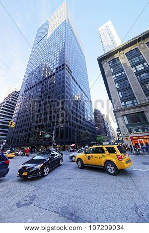 Yellow Car Taxi Speeds Up In Manhattan Streets