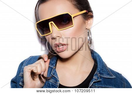 Young Sexy Female Model In Sunglasses On White Background