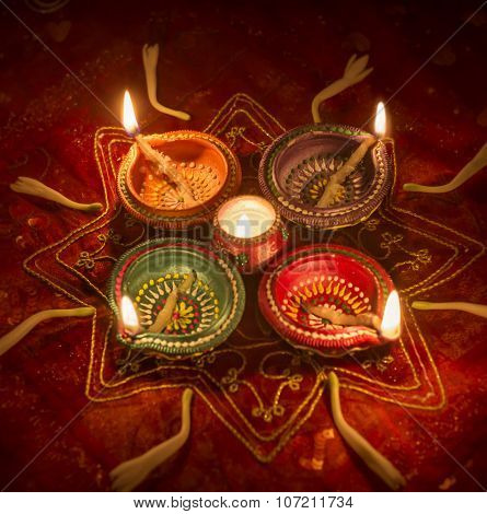 Colorful Diwali lamp background. Group of illuminated earthen lights.