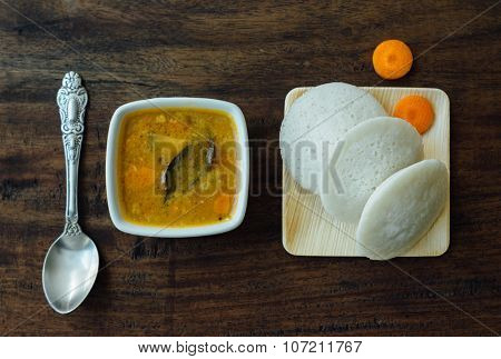 Bowl os sambar with soft Idlis. View from above.