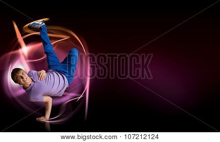 Breakdancer standing on hand
