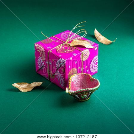 An elegant bright gift box with Diwali lamp. An Indian festive gift.