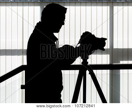 Silhouette Of Video And Photographic Equipment