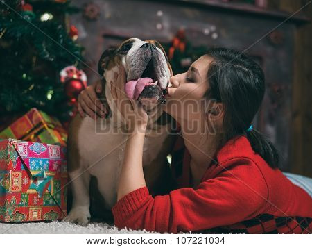 beautiful girl kissing bulldog