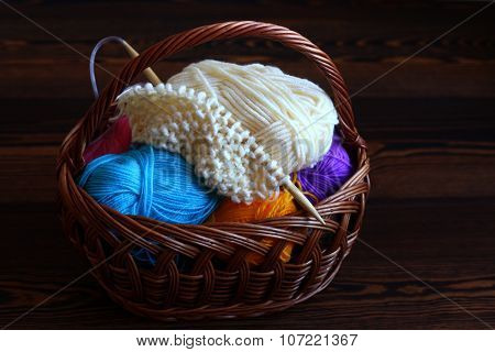 Multi-colored clews in a wicker basket