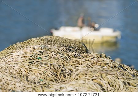 Fishing nets in front of a fishing boat