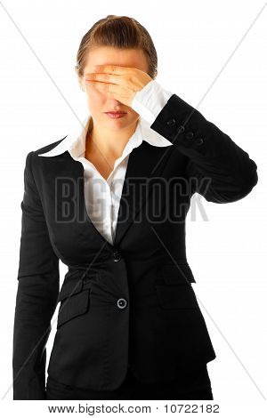 Modern business woman with hand on eyes