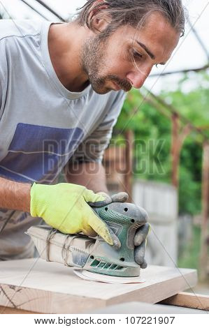 Carpenter Using Electric Sander