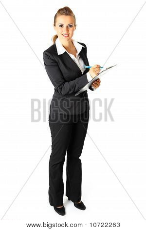 Full length portrait of smiling modern business woman with clipboard and pen