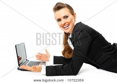 Laying on floor pleased modern business woman using laptops