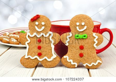 Christmas gingerbread cookie couple with hot chocolate