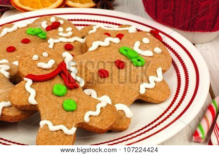 Christmas gingerbread man cookies on a plate close up