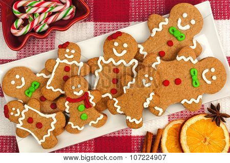 Christmas gingerbread man cookies on plate with checkered background
