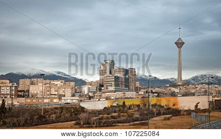 Tehran Skyline And Milad Tower Against Overcast Sky In Autumn