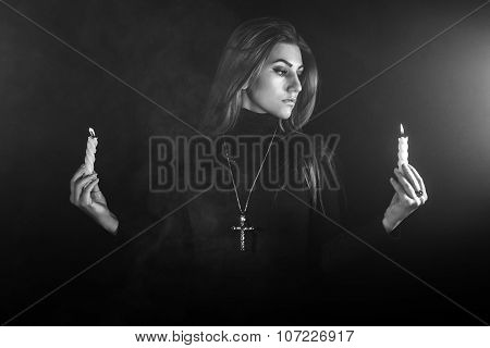 Lonely Woman Holding Two Candles In A Smoke