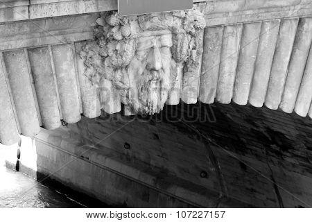 Bottom of a bridge in Paris sculpture