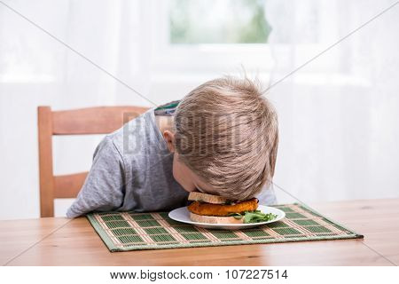 Boy Landing Face In Food