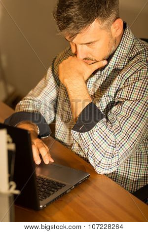 Focused Handsome Man With Laptop