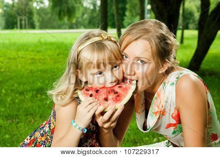 Mother And Daughter Eating Watermelon