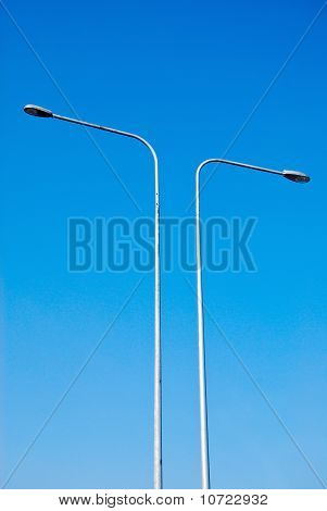 Electricity Lamp Post On The Blue Sky