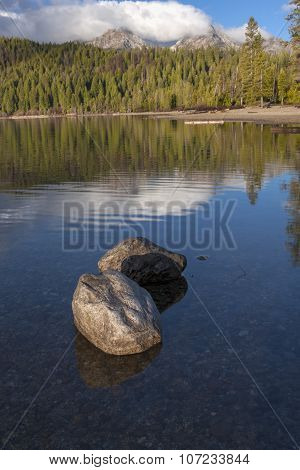 Rocks In Shallow Lake On Sunny Day.