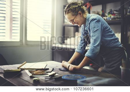 Woman Rolling Clay Craftsman Skill Concept