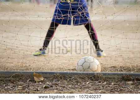 Old Football In Goal, Have A Score