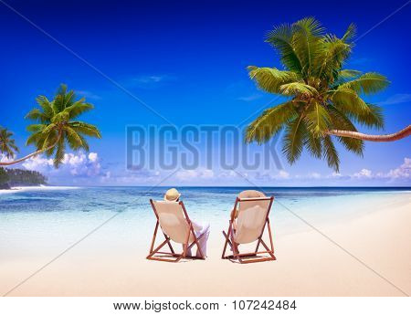 Couple Relaxing on the Beach Tourism Nature Concept