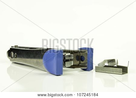 Staples And Stapler On White Background, Isolated