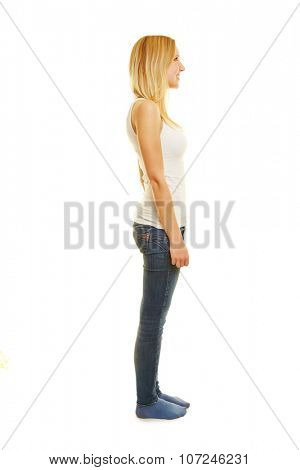 Fully body shot in side view of young slim blonde woman