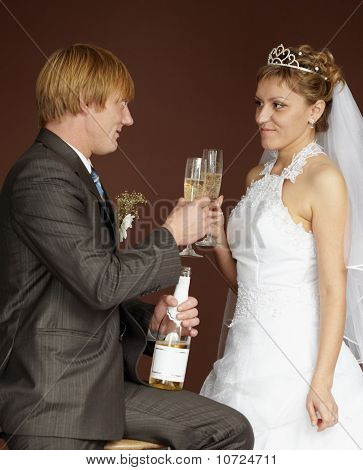 Newlywed Drinking Champagne Clinking Glasses