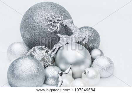 Festive Silver Grey Shiny Christmas Ornaments With Santa's Ninth Reindeer At Natural Snow Backgr