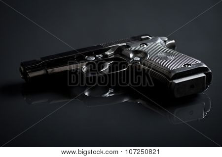 the handgun on black background