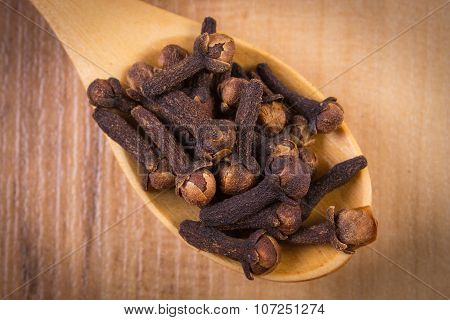 Heap Of Cloves With Wooden Spoon On Table, Seasoning For Cooking