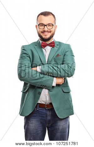Vertical shot of a young confident hipster with a green coat and a red bow-tie isolated on white background