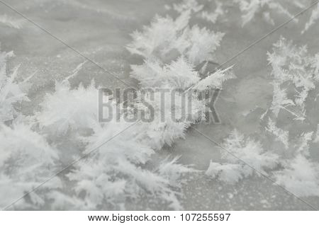 Streaks Of Snow. Snowflakes On The Ice. Winter And Frost. Ice Sheet